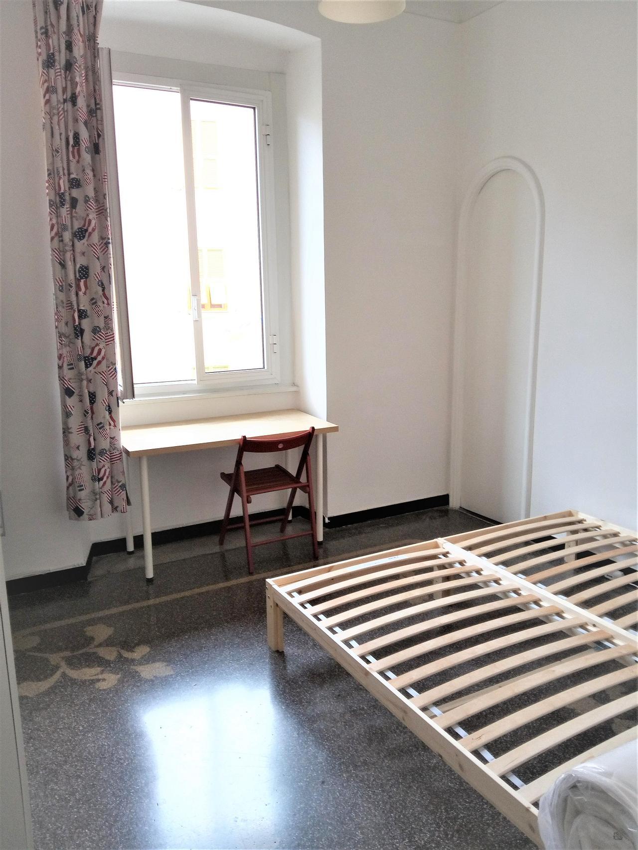 Copertina camera in affitto a Genova